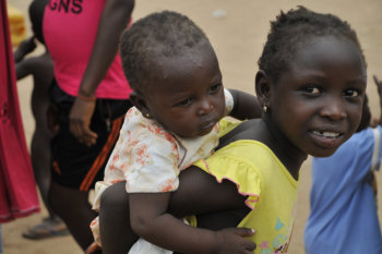 A girl and baby sister during our medical mision