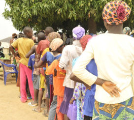 Young girls on que to receive medical care
