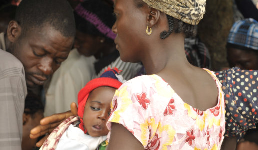 mother and a child in a crowded place